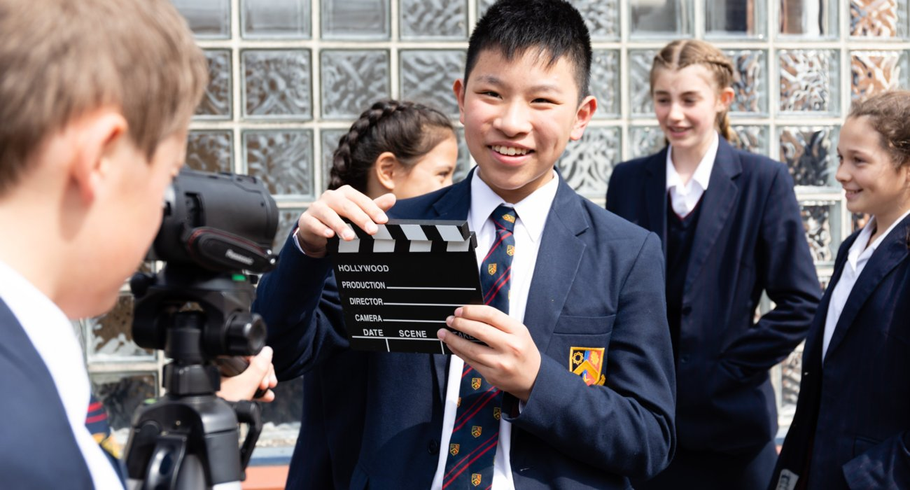 Students Working on a Video Outside Sixth Form