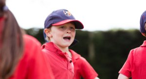 Henry in St Joseph's Baseball Cap Laughing