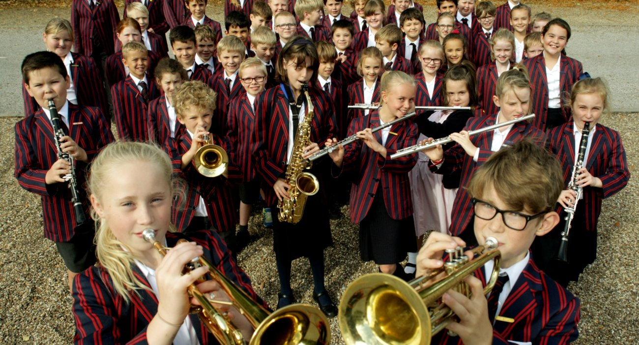 Group Shot of Prep Pupils. Many with Musical Instruments
