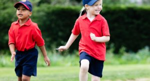 Nursery Boy and Girl Enjoy Outdoor PE