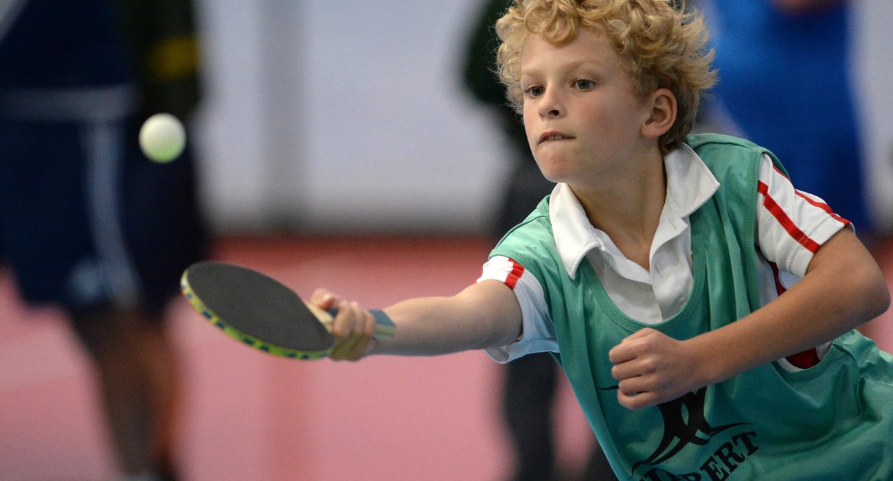 Prep Boy Playing Table Tennis