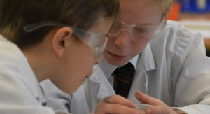 Boys in Goggles Ponder a Chemical Reaction