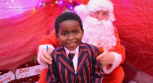 Nursery Boy Poses with Father Christmas