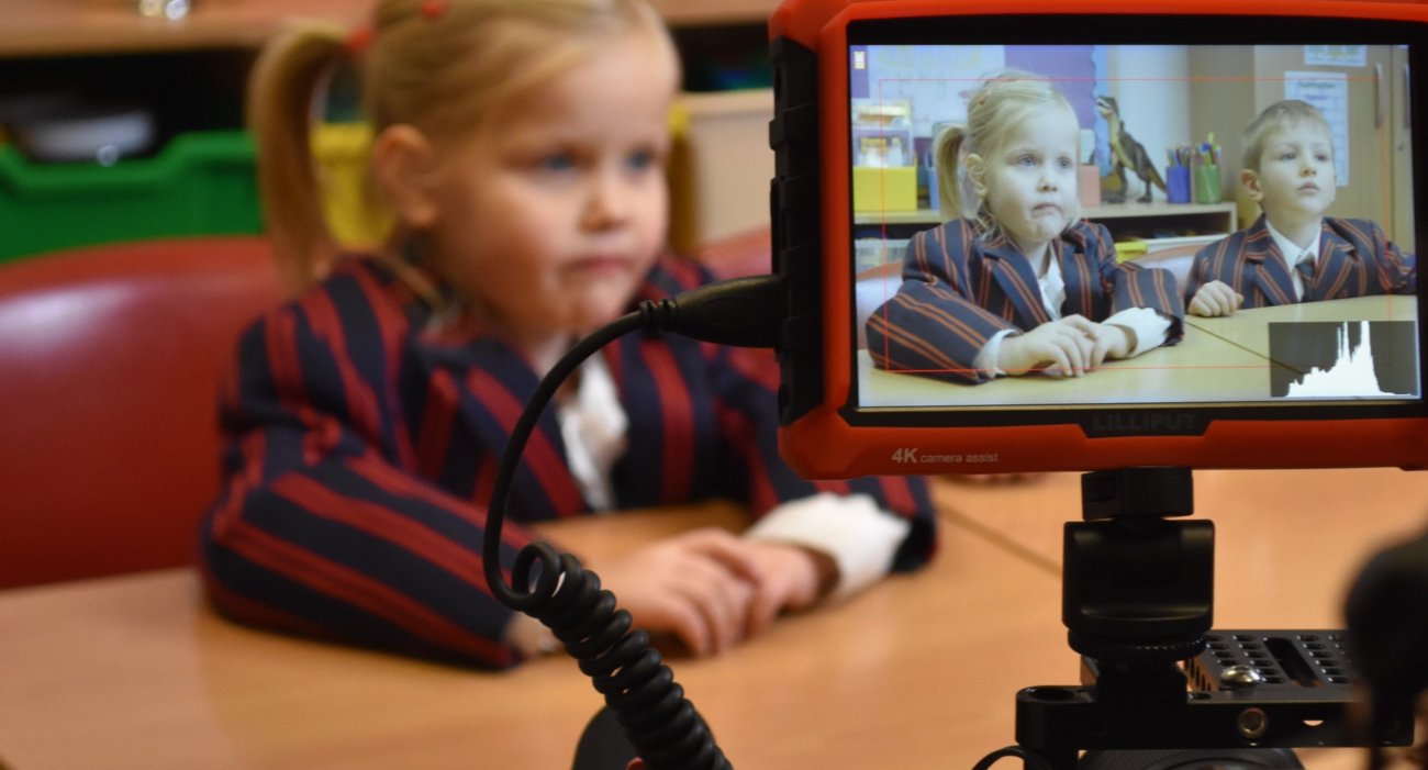 A Nursery Girl Speaks to Camera During Filming