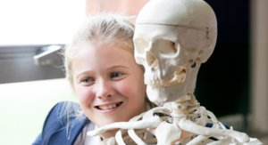 Girl Gets Up Close to Skeleton